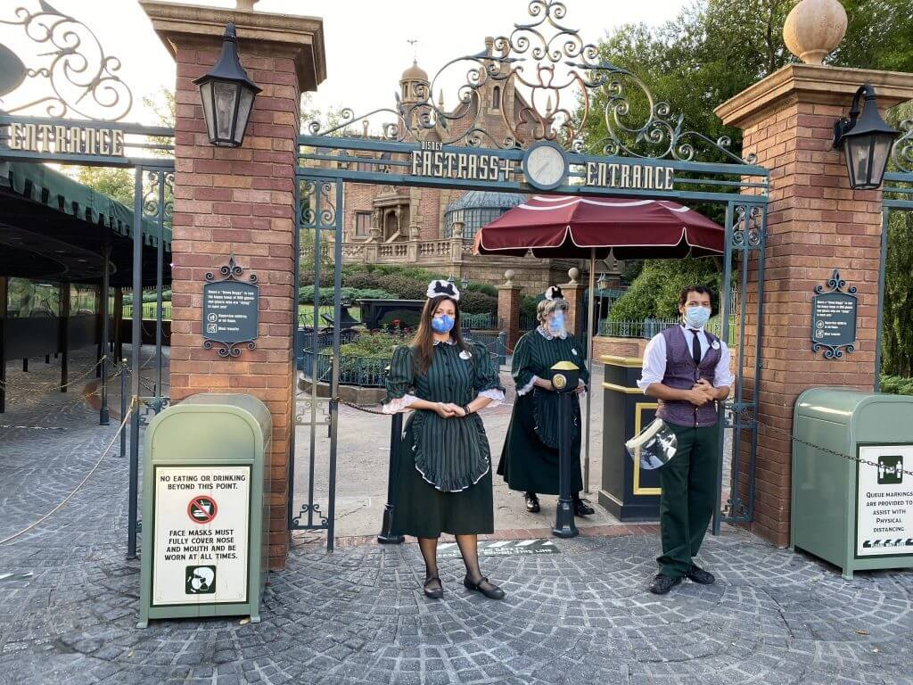 Cast Members in mask Haunted Mansion Magic Kingdom